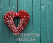 Heart made of straw , decoration on an old wooden gate , Southern Palatinate , Rhineland Palatinate , Germany , Europe